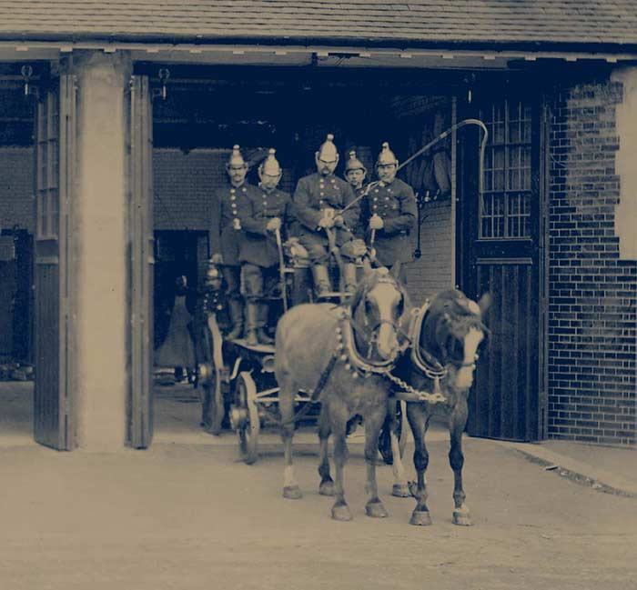 Horse drawn fire engines leaving the station - Brigade Court SE1 apartments